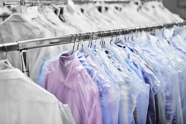 Laundry Bags Many Tshirts On Rack
